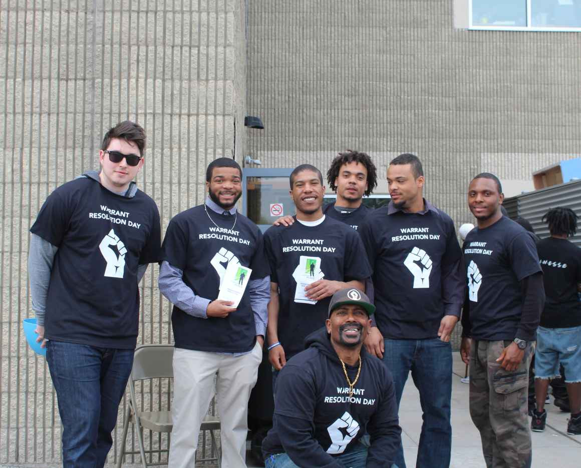 group of people with warrant forgiveness day t-shirts