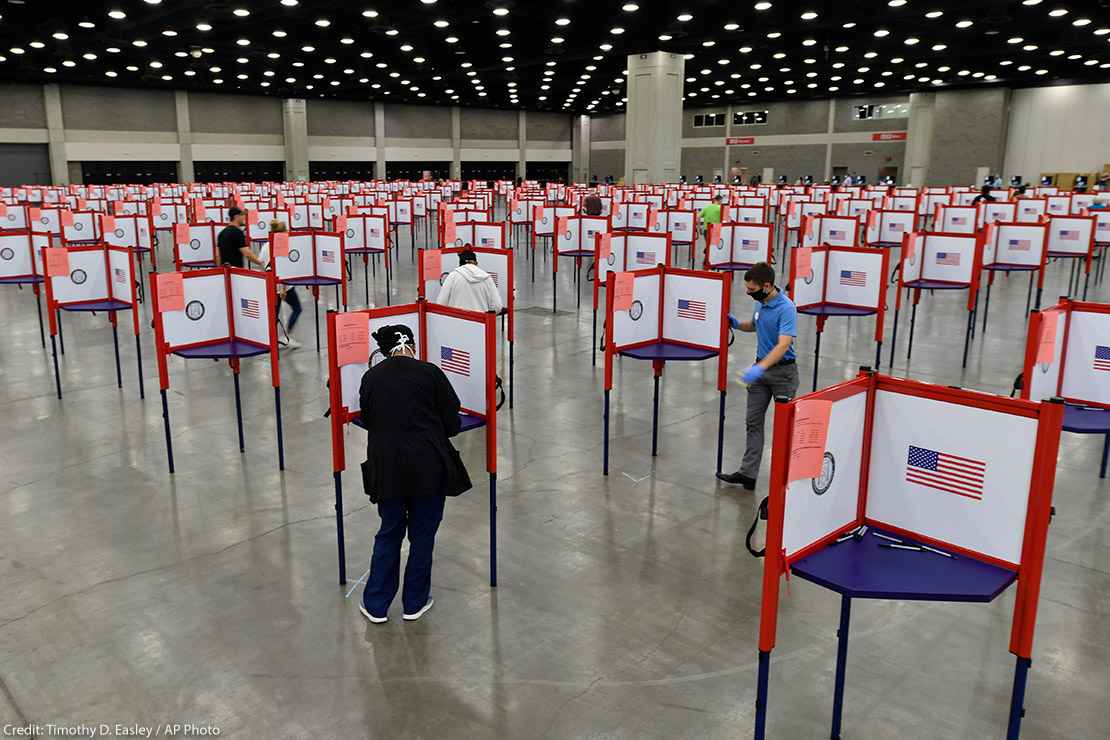 Photo of multiple voting stations set up in the Kentucky Exposition Center for voters to cast their ballot.