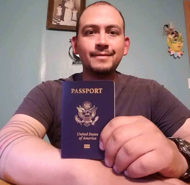 Mark Esqueda with his new passport