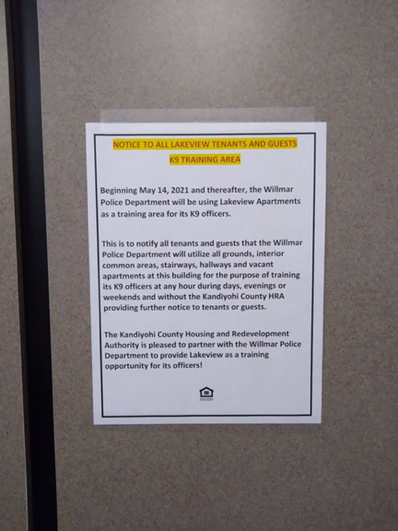 A sign posted informs residents about the K-9 training partnership.
